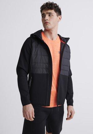 SUPERDRY GYMTECH HYBRID JACKET - Light jacket - black