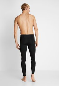 Puma - IGNITE LONG TIGHT - Tights - black - 2