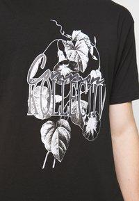 Common Kollectiv - FLORAL UNISEX - Print T-shirt - black - 3