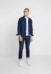 Levi's® - THE TRUCKER JACKET - Farkkutakki - dark-blue denim - 1