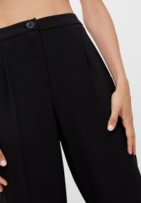 Bershka - Trousers - black - 3