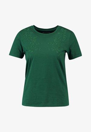 T-shirts med print - eden