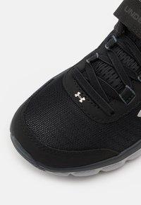 Under Armour - ASSERT 8 UNISEX - Neutral running shoes - black - 5