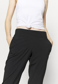 Casall - CLASSIC SLIM PANTS - Outdoor trousers - black - 4
