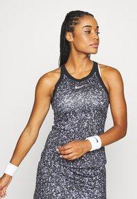Nike Performance - DRY TANK PRINTED - Camiseta de deporte - black/white - 0