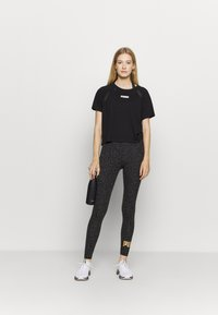 Puma - LEGGINGS - Medias - black - 1