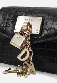 DKNY - ELISSA MICRO MINI CROCO XBODY - Across body bag - black/gold - 3