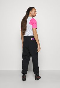 Nike Performance - PARIS ST GERMAIN PANT - Tracksuit bottoms - black/psychic purple - 2