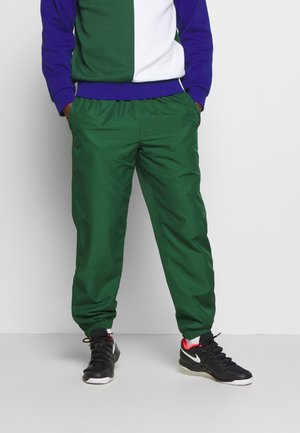TENNIS PANT - Trainingsbroek - green