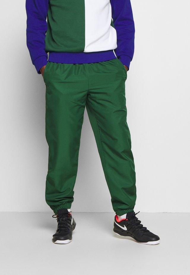TENNIS PANT - Tracksuit bottoms - green