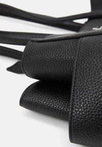 Vivienne Westwood - JOHANNA LARGE SHOPPER BAG UNISEX - Tote bag - black - 5