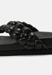 Toral - T-bar sandals - black - 5