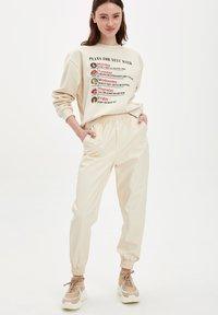 DeFacto - Trousers - ecru - 1
