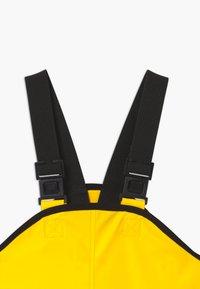 Reima - LAMMIKKO - Pantalones impermeables - yellow - 2
