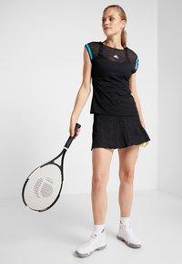 adidas Performance - MCODE SKIRT - Sports skirt - black - 1