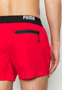 Puma - SWIM MEN LOGO SHORT LENGTH - Swimming shorts - red - 3