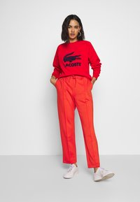 Lacoste - HF5430-00 - Tracksuit bottoms - red - 1
