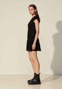sandro - ODETTE - Cocktail dress / Party dress - noir - 1