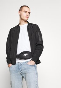 Nike Sportswear - HERITAGE - Bum bag - black/white - 1