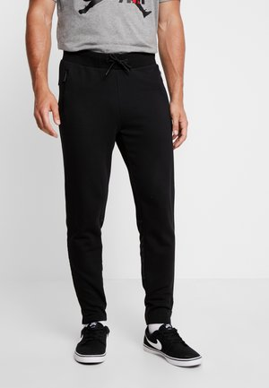 MILITARY - Tracksuit bottoms - black