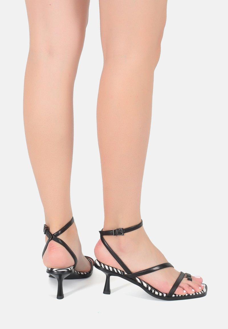Ekonika - T-bar sandals - zebra-black