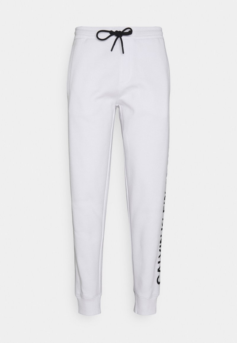 Calvin Klein Jeans - VERTICAL LOGO PANT - Tracksuit bottoms - bright white