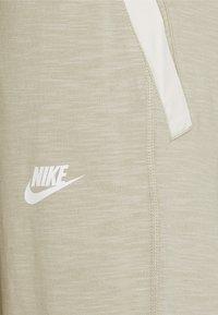 Nike Sportswear - Pantalones deportivos - grain/coconut milk/ice silver/white - 7