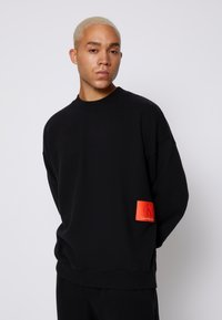 Calvin Klein Jeans - OVERSIZED BADGE - Sweatshirt - black - 0
