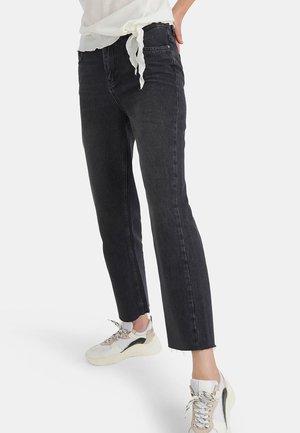 LIEKE - Flared Jeans - black