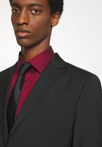 Calvin Klein Tailored - TROPICAL STRETCH SUIT - Suit - black - 7