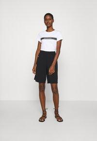 Calvin Klein - TRAVEL CREPE  - Shorts - black - 1