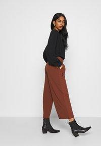 JDY - JDYGEGGO NEW ANCLE PANTS - Trousers - cherry mahogany/black - 4