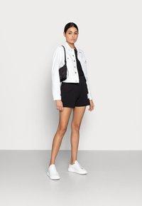 Calvin Klein Jeans - CROPPED  DENIM JACKET - Denim jacket - white - 1
