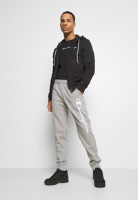 Champion - LEGACY CUFF PANTS - Tracksuit bottoms - mottled grey - 1