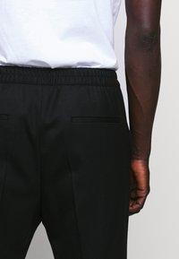 HUGO - HARLYS - Trousers - black - 3