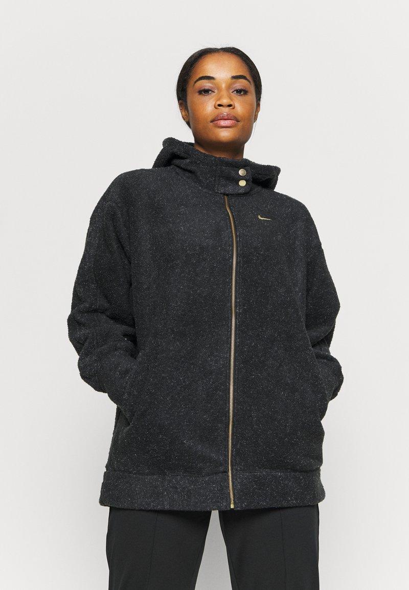 Nike Performance - COZY - Fleece jacket - black/metallic gold