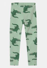 Lindex - MINI CROCO UNISEX - Leggings - Trousers - light green - 1