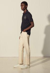 sandro - Polo shirt - marine - 1