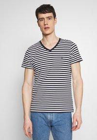 Tommy Hilfiger - STRETCH SLIM FIT VNECK TEE - T-shirt basic - blue/white - 0
