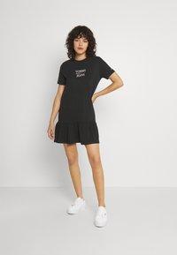 Tommy Jeans - LOGO PEPLUM TEE DRESS - Day dress - black - 1