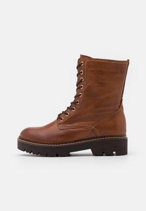 LEATHER - Platform ankle boots - cognac