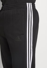 adidas Performance - ESSENTIALS TRAINING SPORTS PANTS - Spodnie treningowe - black/white - 4