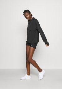 Nike Performance - RUN - Sports jacket - black/bright crimson - 1