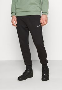 Nike Sportswear - REPEAT - Tracksuit bottoms - black - 0