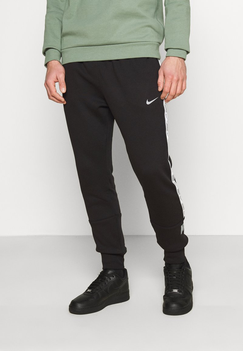 Nike Sportswear - REPEAT - Tracksuit bottoms - black