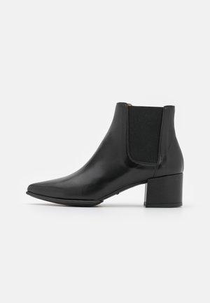 JUANIN - Kotníková obuv - black