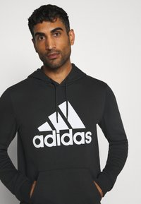 adidas Performance - ESSENTIALS SPORTS INSPIRED HOODED - Sweat à capuche - black - 3
