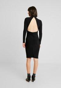 Club L London - OPEN BACK RUCHED LONG SLEEVE BODYCON DRESS - Shift dress - black - 3