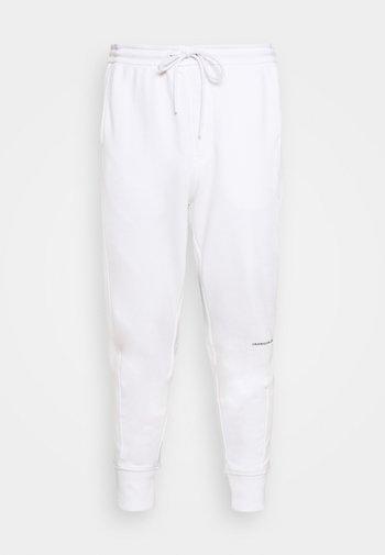 MICRO BRANDING PANT - Tracksuit bottoms - white