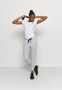 Under Armour - RIVAL PANTS - Tracksuit bottoms - steel medium heather - 1